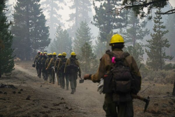 Huge wildfire near Lake Tahoe slows as weather improves