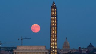 A full moon, known as a Harvest Moon, rises over Washington, D.C., on Sept. 19, 2013.