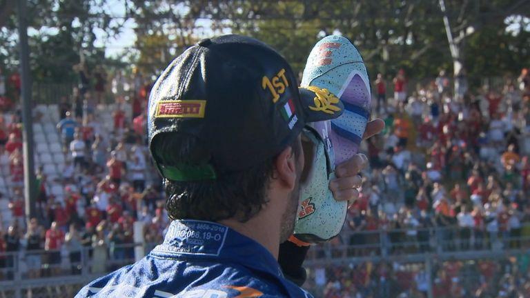 After winning the Italian Grand Prix, Daniel Ricciardo celebrates by doing his traditional 'shoey' celebration.