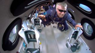 Virgin Galactic founder Richard Branson soars like Superman while in weightlessness during his Unity 22 launch on the SpaceShipTwo VSS Unity on July 11, 2021.